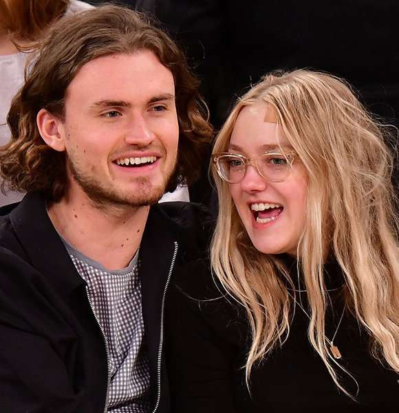 Dakota Fanning along with Henry Frye are happy