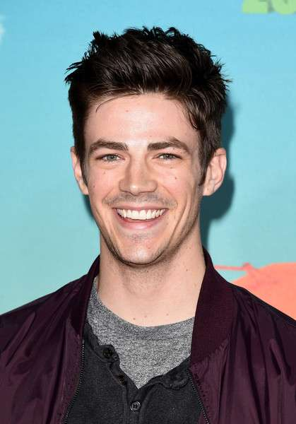 Grant Gustin in happy
